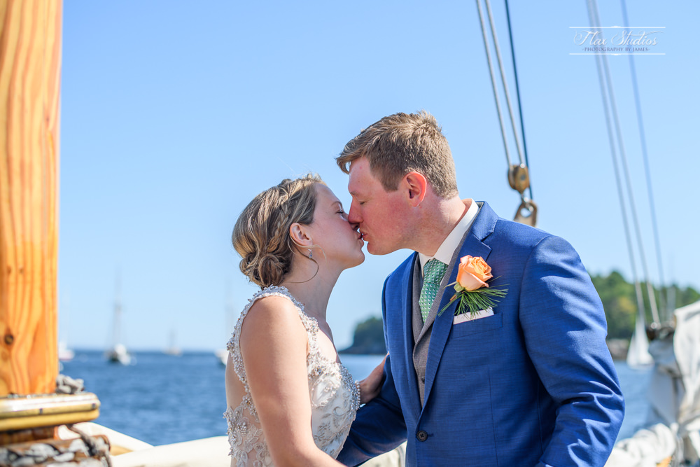 first kiss on the sailboat as husband and wife