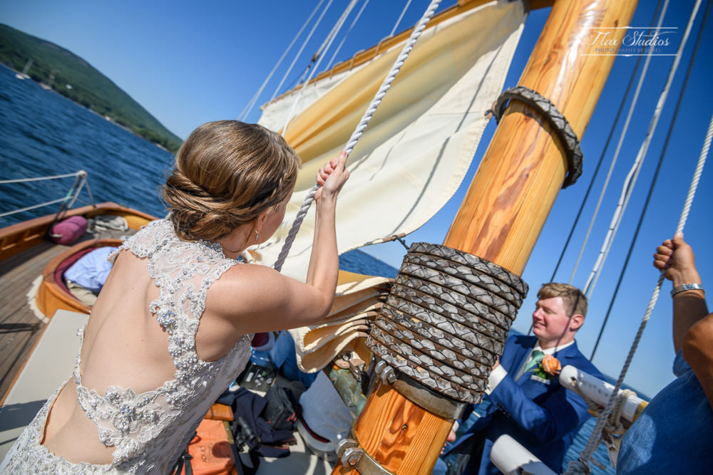 The Bride raising the sails on the schooner olad