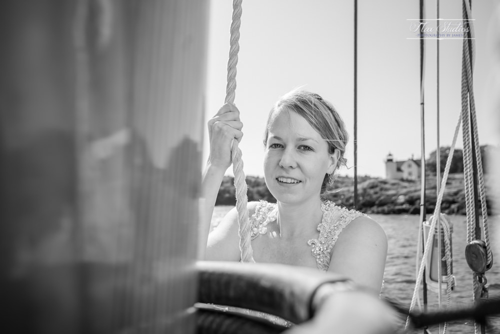 black and white photo of the bride on a sailboat