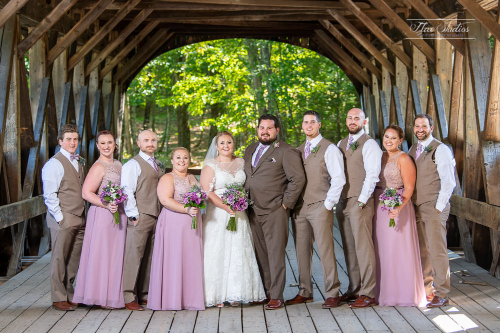 full wedding party photo on the covered bride at sunday river