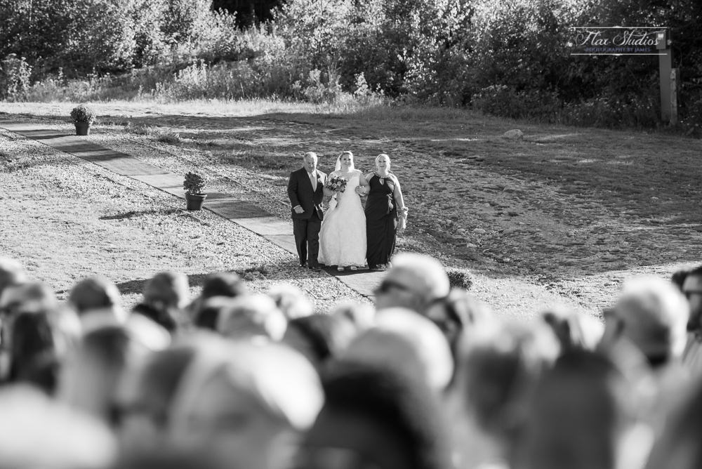 the brides parents walking her down to the ceremony