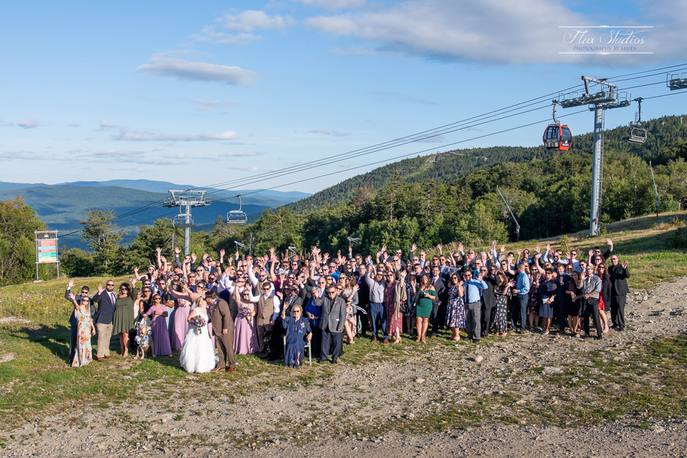 group wedding photo with all the guests on top of north peak at sunday river