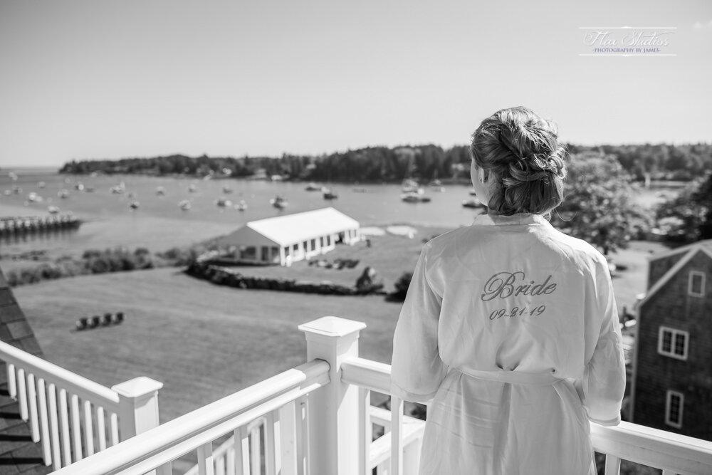 the bride overlooking the ocean in tenants harbor