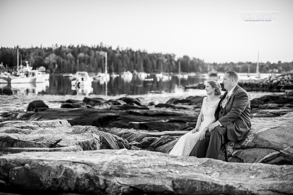 black and white wedding photo on the rock in tenants harbor maine