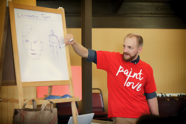 Ross Boone teaching illustration at the Paint Love event at Camp Horizon
