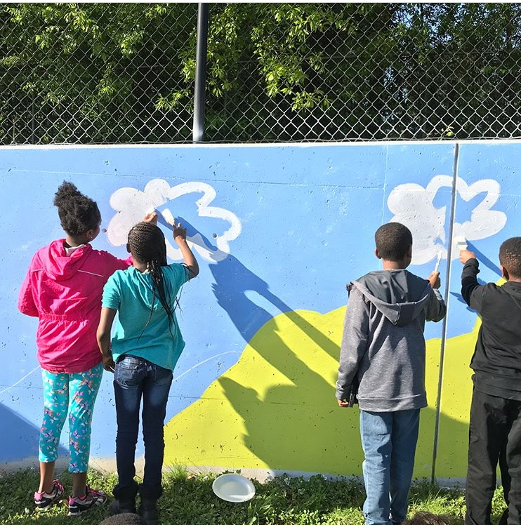 Paint Love artist Brent Coleman lead Clarkdale Elementary students
