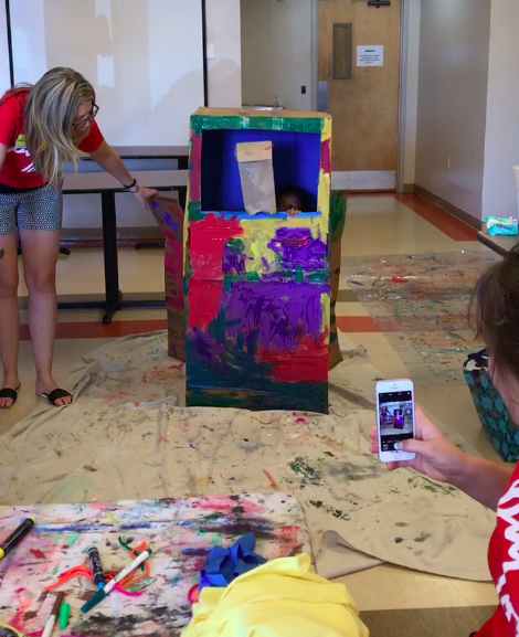 Paint Love led a puppet show project at Our House Atlanta with kids who are facing homelessness.
