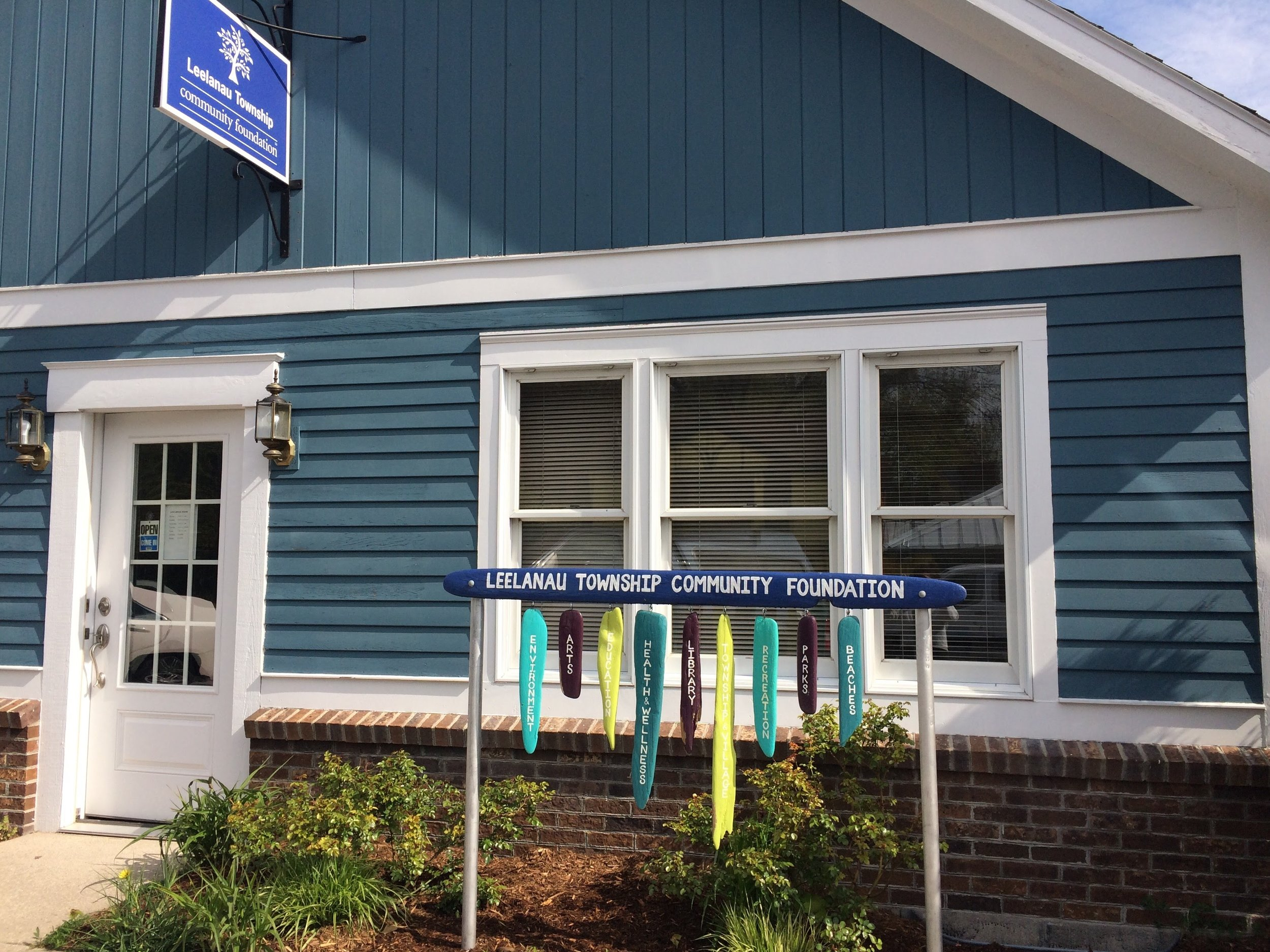 Our new office on 301 Mill Street in Northport! The driftwood sign, created by artist Julie Glidden for the foundation's 70th year celebration, captured the many areas of community interest that the foundation has supported since it was founded in 1945.
