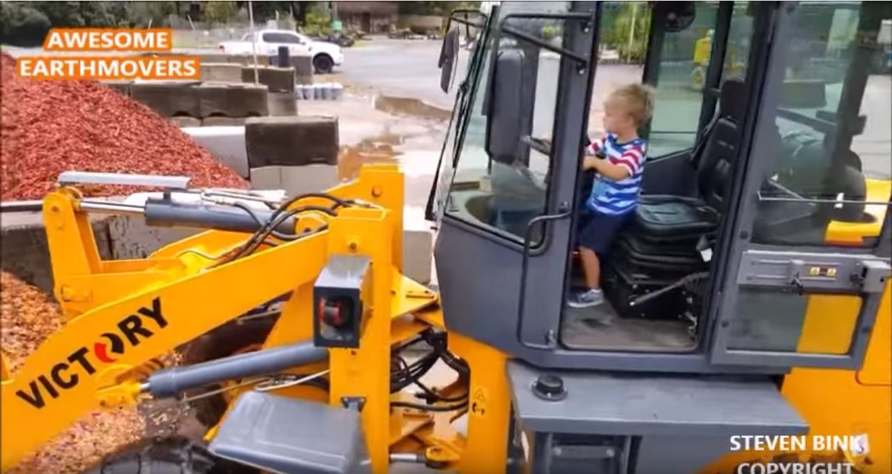 child operating wheel loader