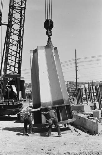 Workers_guiding_base_of_Space_Needle_leg_into_place_ca_June_30_1961.jpg
