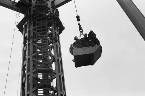 Workers_ride_skip_up_to_Space_Needle_core_ca_July_1961.jpg