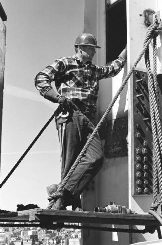 Worker_stands_on_construction_float_off_of_Space_Needle_leg_ca_September_8_1961.jpg