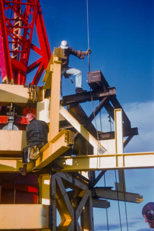 Workers_at_base_of_Space_Needle_torch_ca_December_8_1961.jpg