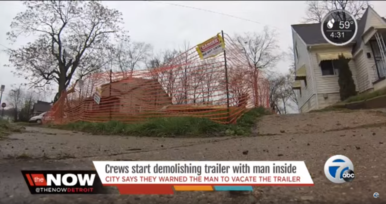 trailer demolished with man inside
