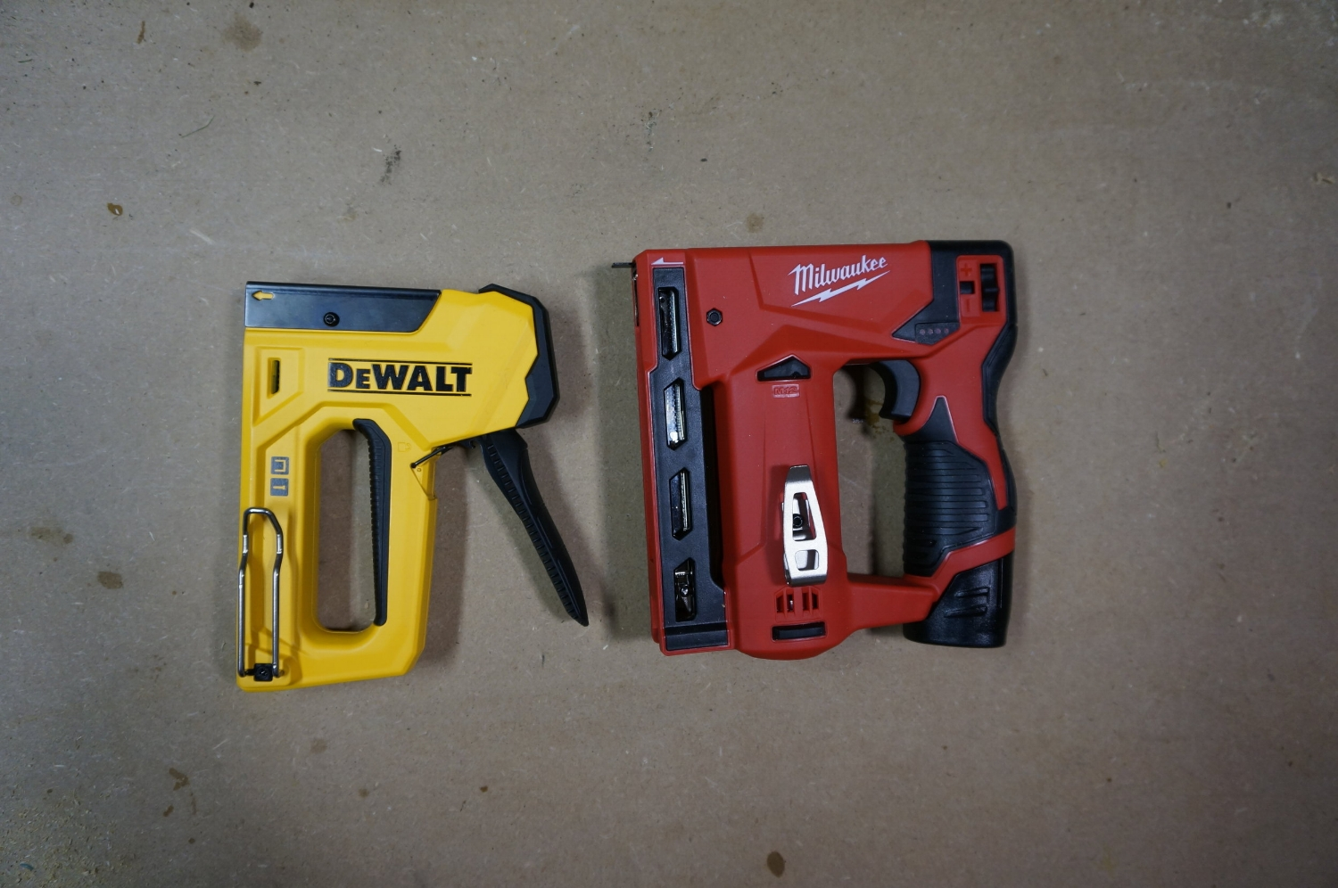 Size comparison between common DeWalt squeeze tacker and the Milwaukee M12 Stapler
