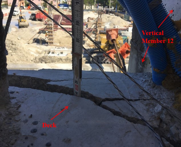 NTSB description: Location: Diaphragm II, west side directly adjacent to vertical member 12, top deck view of crack, looking to the north. Time stamp: March 13, 2018, at 11:16:50 a.m., labels added by the NTSB. (Source: Munilla Construction Management)