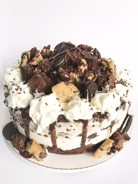 Top your cake with the remaining brownies, chocolate chip cookies, oreos, fudge and whipped cream. Keep it in the freezer until your ready to eat it and enjoy every last bite!