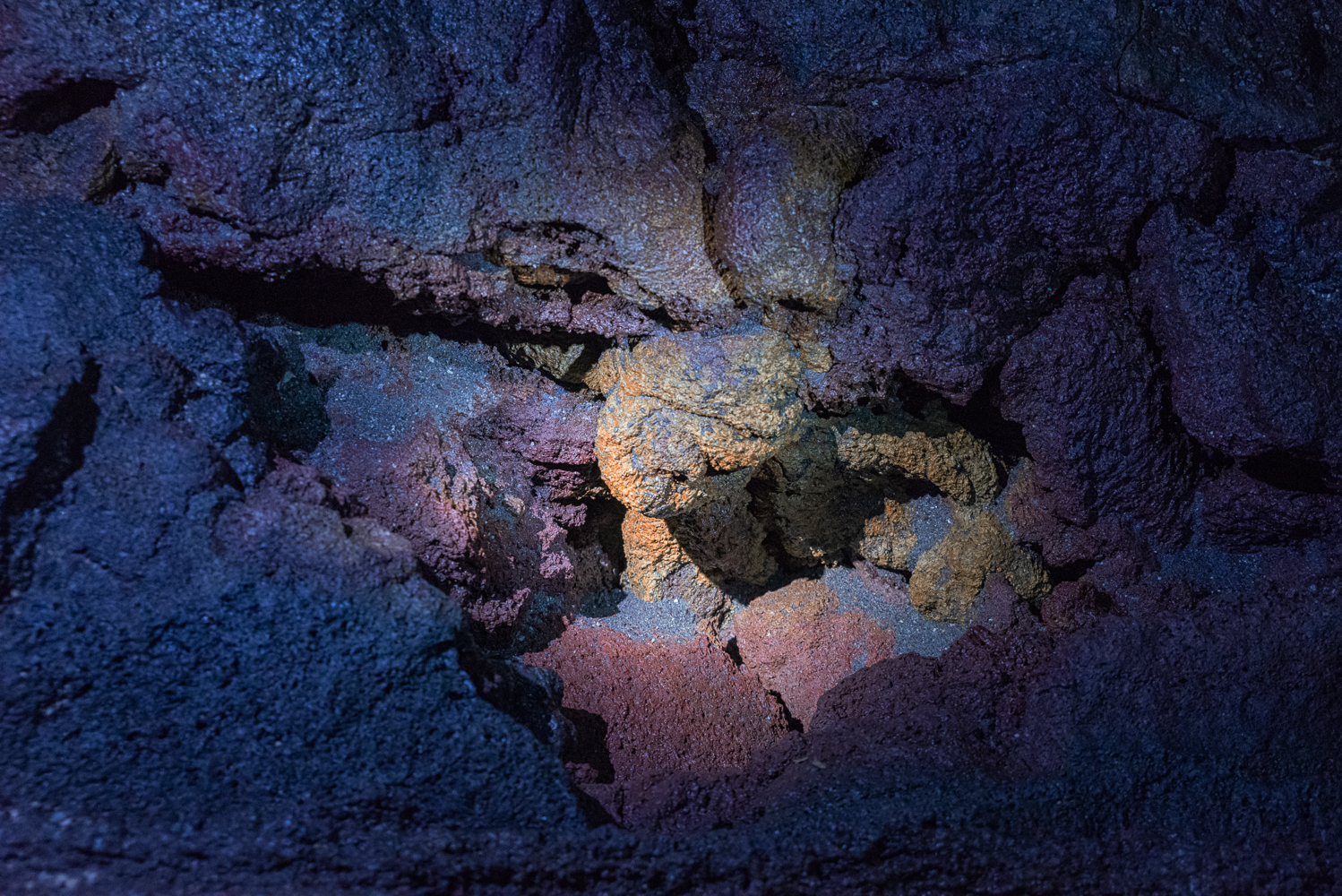 There are some alien worlds down below … or at least some quirky shapes and colors in a lava tube!