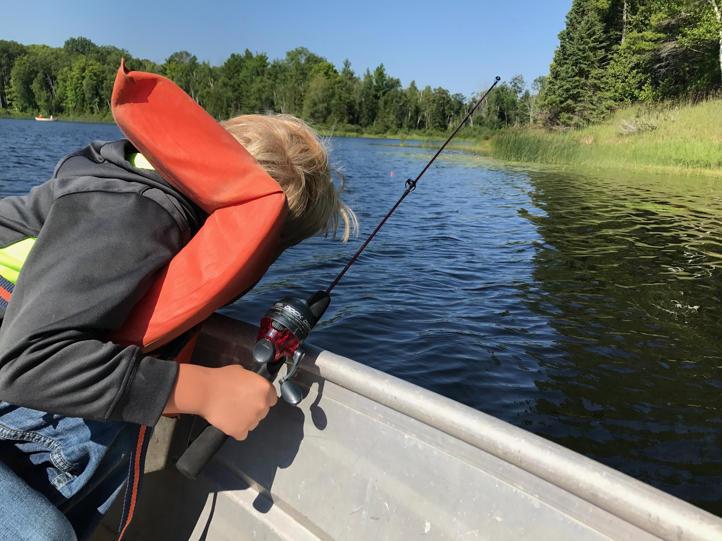 My son, bored out of his mind, right before we turned back to shore. See the bobber? Yeah, it never went under and we didn't catch a single fish :-/.
