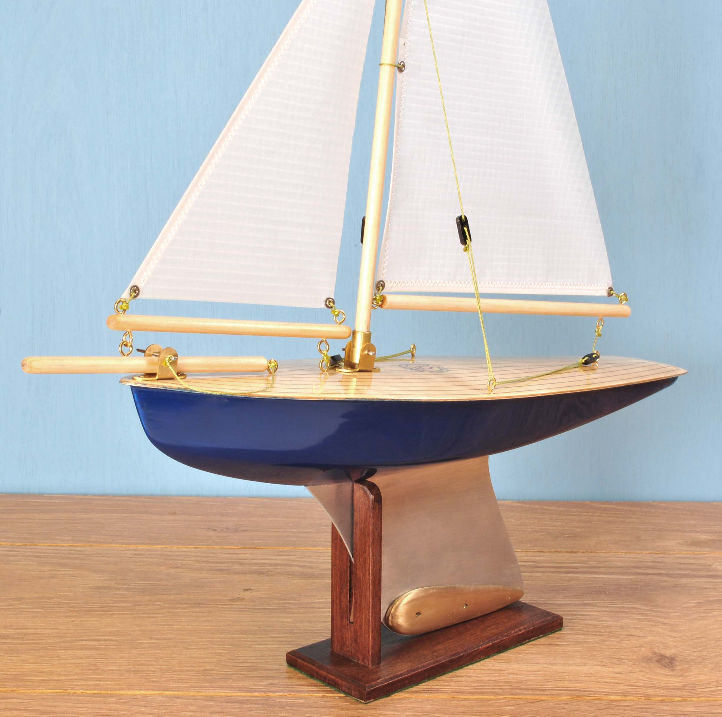 "Out of Stock   ""Sapphire""   Painted hull, light birch deck, spinnaker cloth sails."