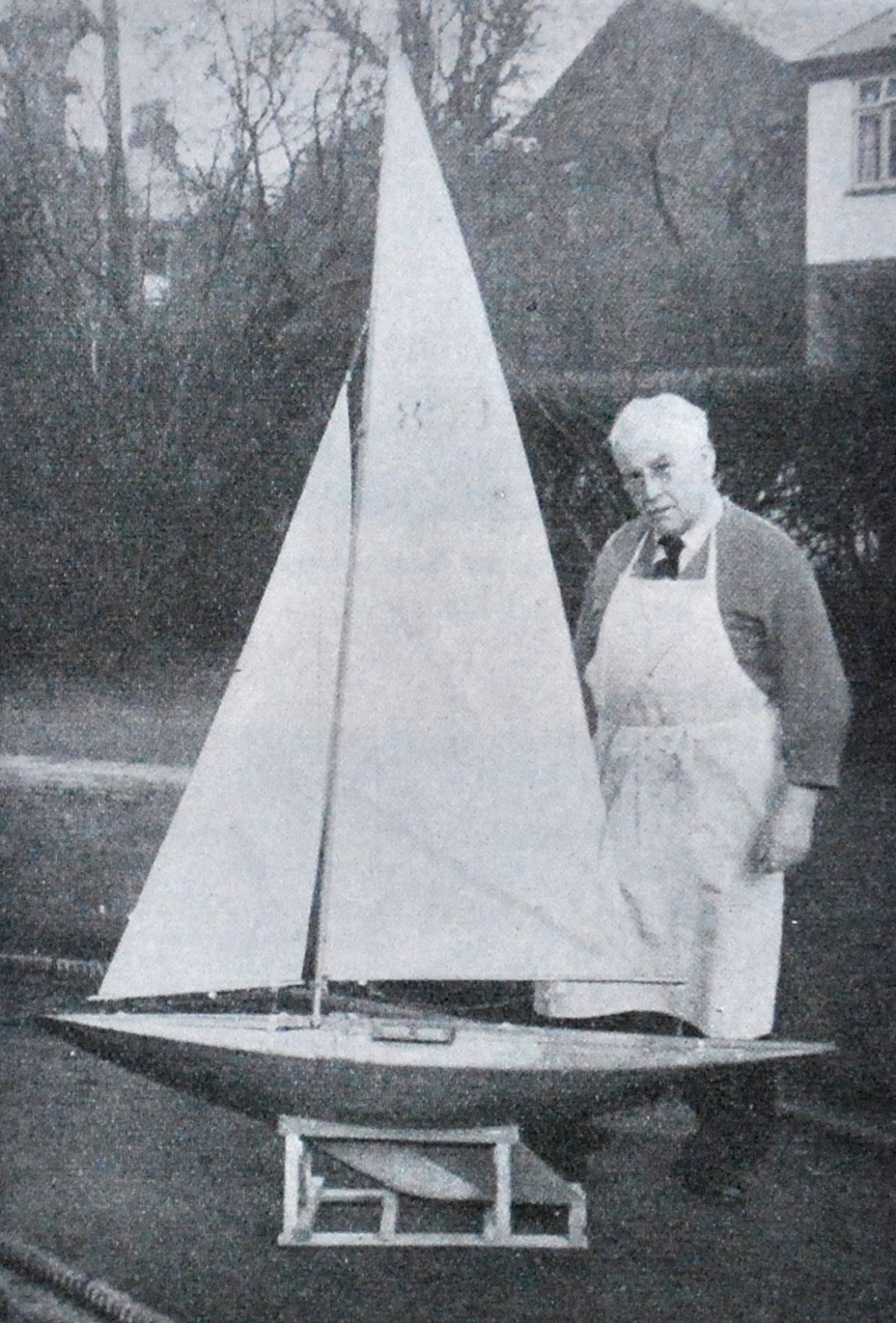 Mr John Alexander with one of his 6 Metre yachts.