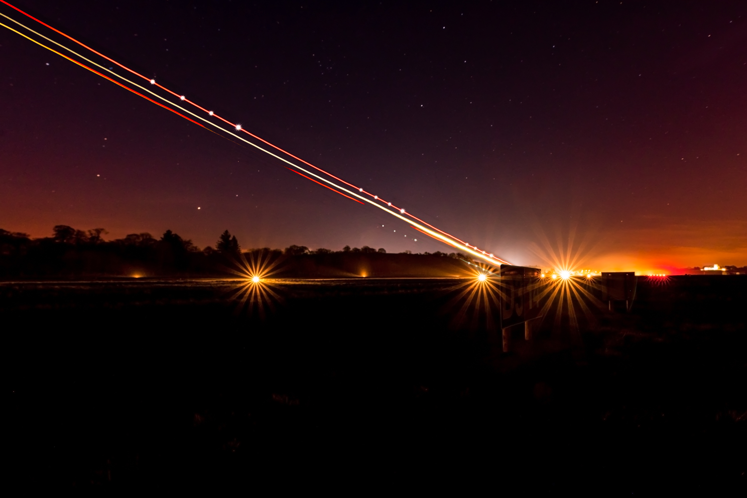 This image was taken of a plane departing Enniskillen/St Angelo Airport into the starry night sky. It was a 30 second exposure at f/9.0 and ISO-800. The lens locked focus almost instantly on the landing light.