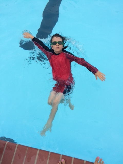 Here is a picture of Ian: Throughout the summer we were able to practice free style and backstroke. With the lessons I provided along with his hard work he gained a lot of confidence in the water. As you can see he ended making a serious splash in the water by swimming his favorite stroke, backstroke.