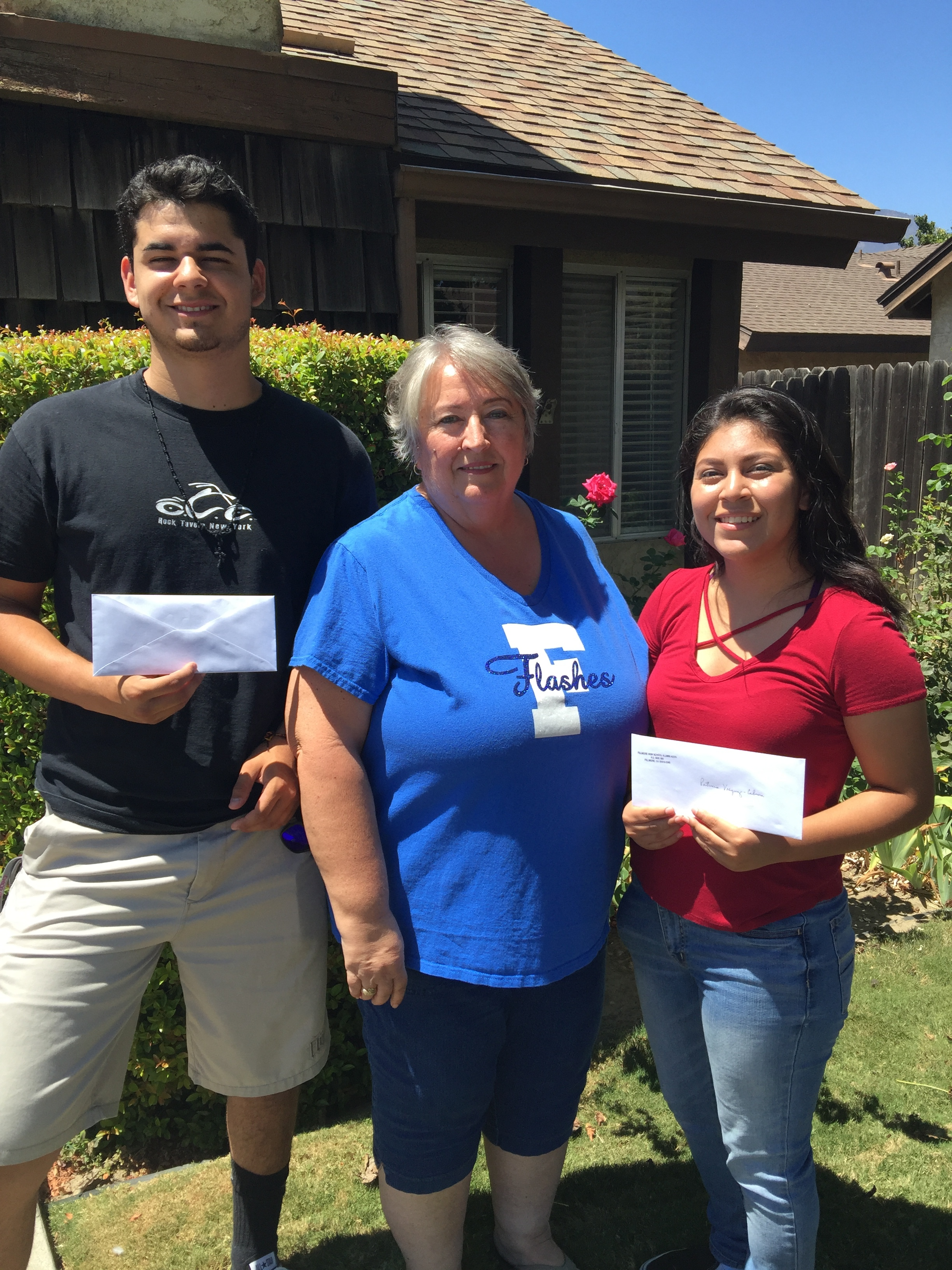 """Emilio Hernandez '15 (Chico State), and Patricia Vasquez-Cabrera '15 (UC San Diego) receive their continuation grant award from Scholarship Committee member, and Vice President of the Alumni Assn, Corinna """"Chandler"""" Mozley '71."""