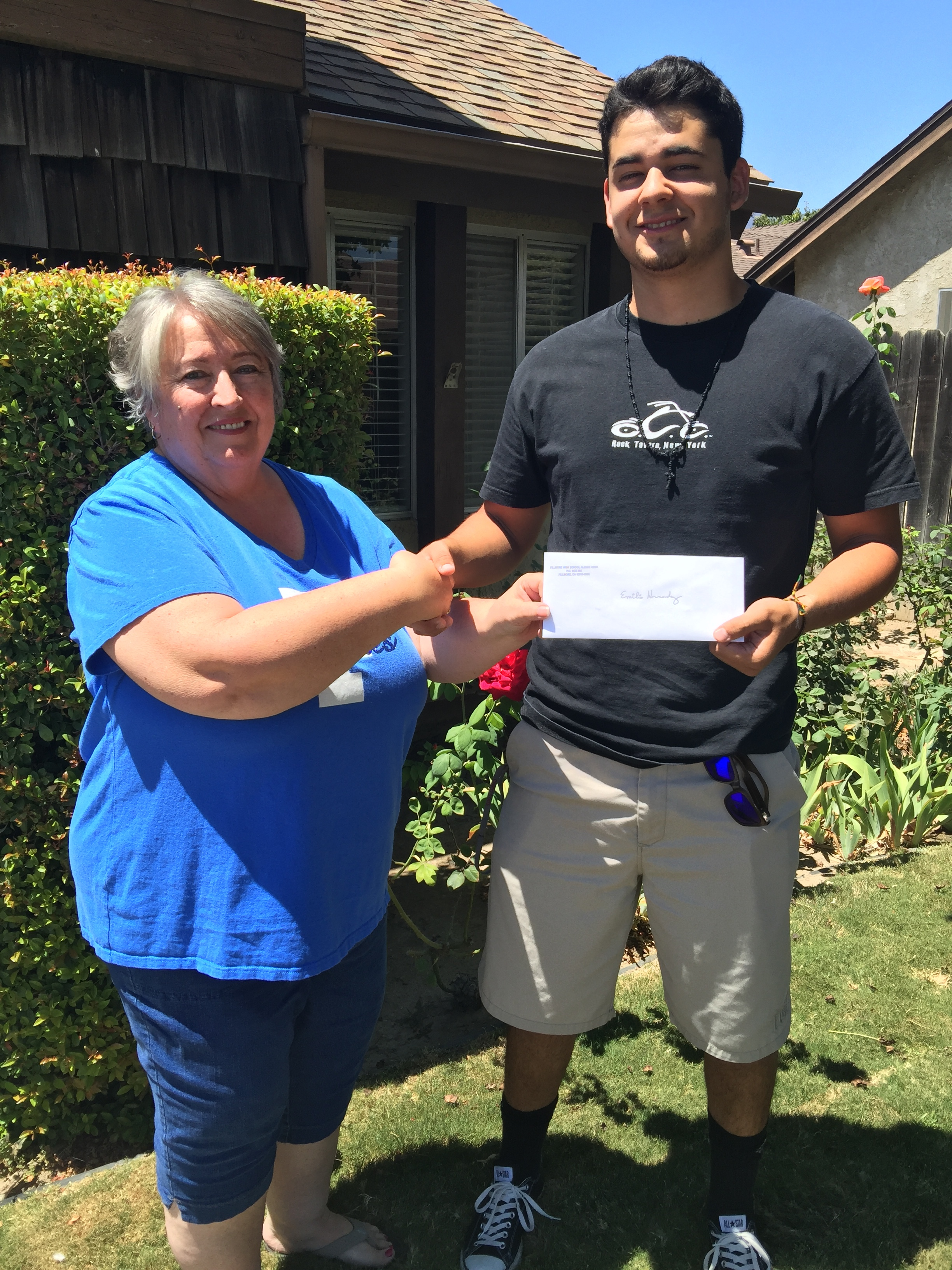 """Emilio Hernandez, Class of 2015 receives his continuing education grant from Vice President of the Fillmore High Alumni Association, Corinna """"Chandler"""" Mozley. '71. Emilio is attending Chico State University and majoring in Economics. He is on schedule to Graduate in 2019. Congrats Emilio!"""