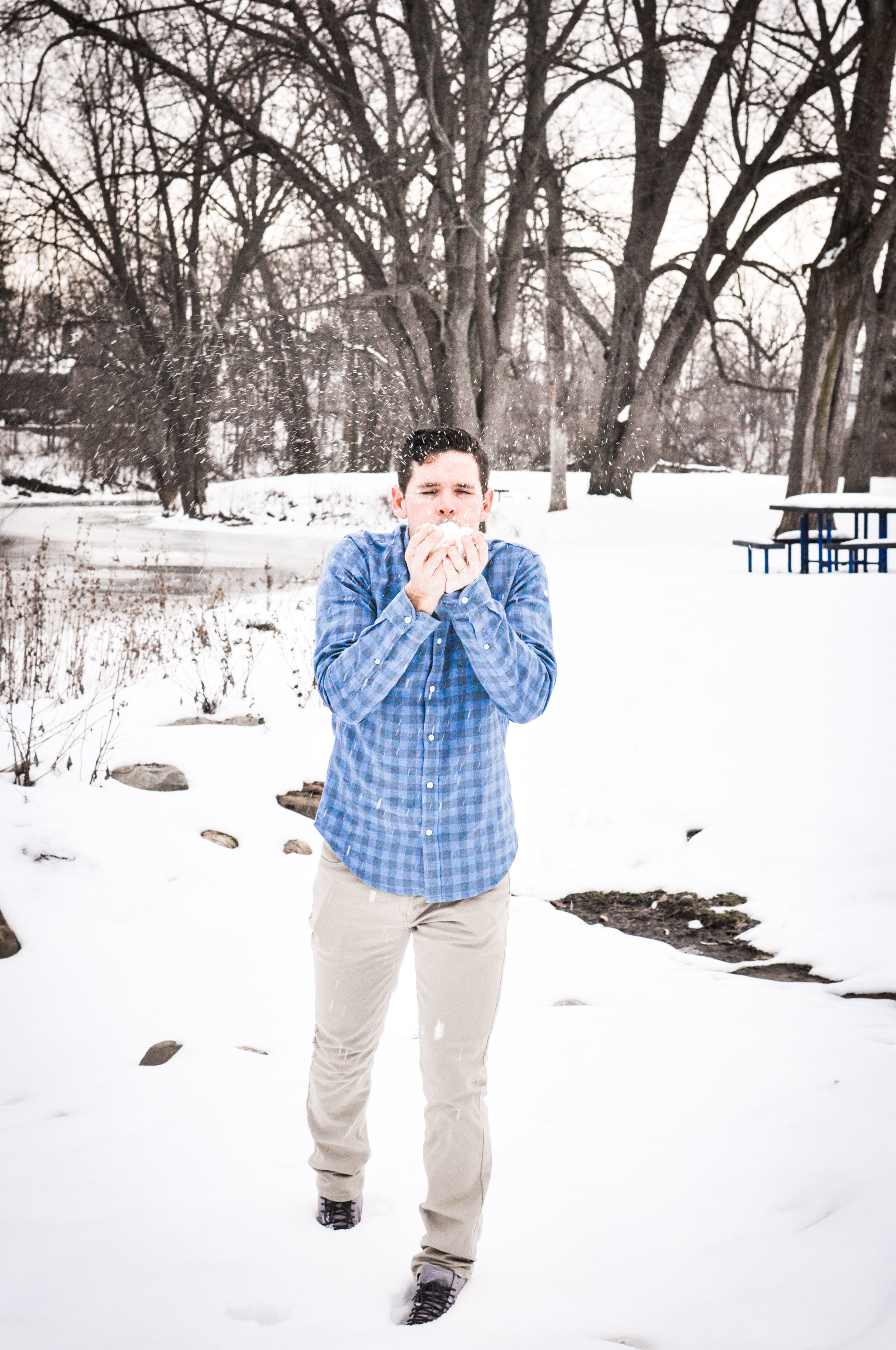 Man in gingham blue shirt in snow