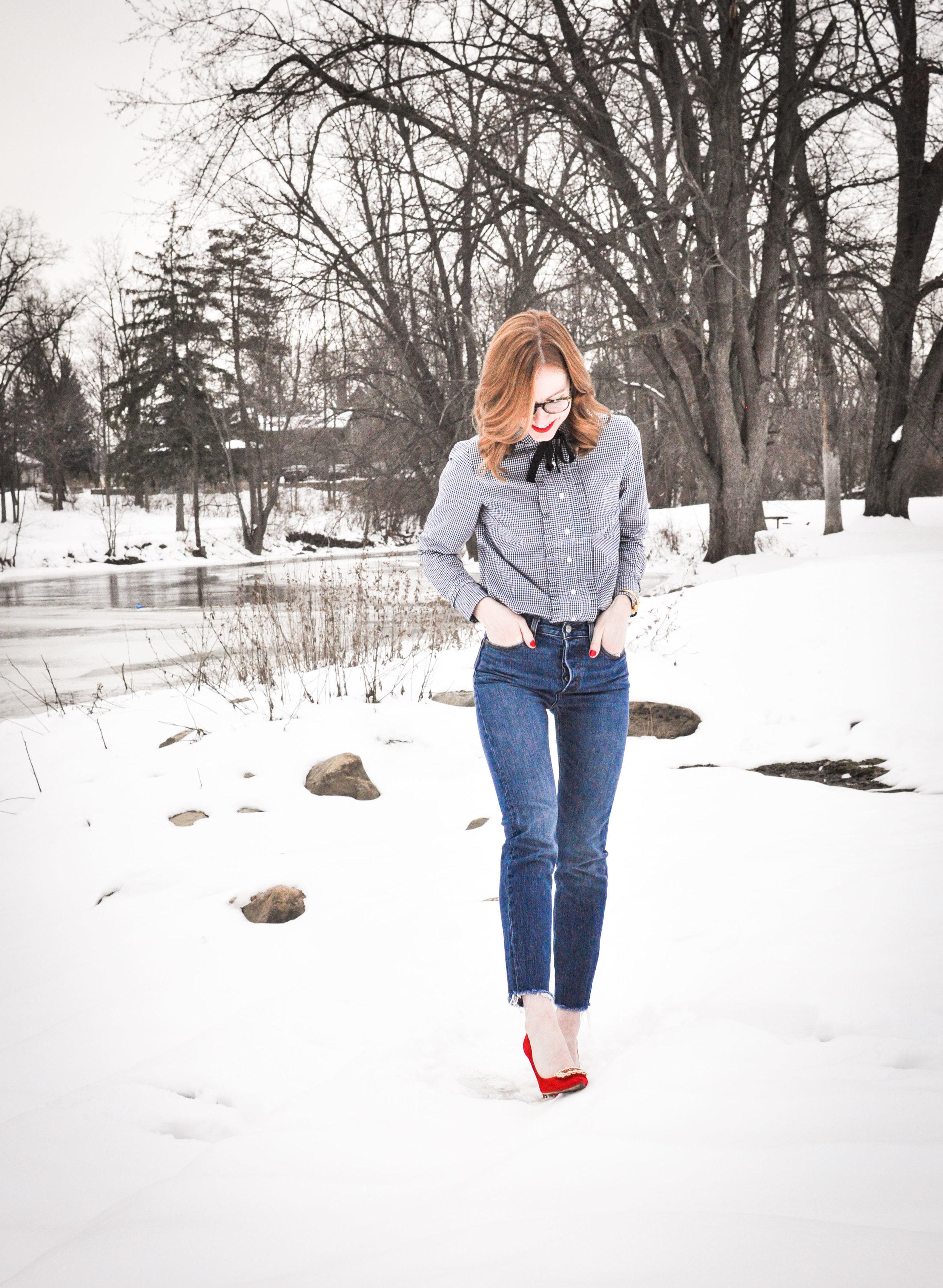 Woman in jeans walking in snow