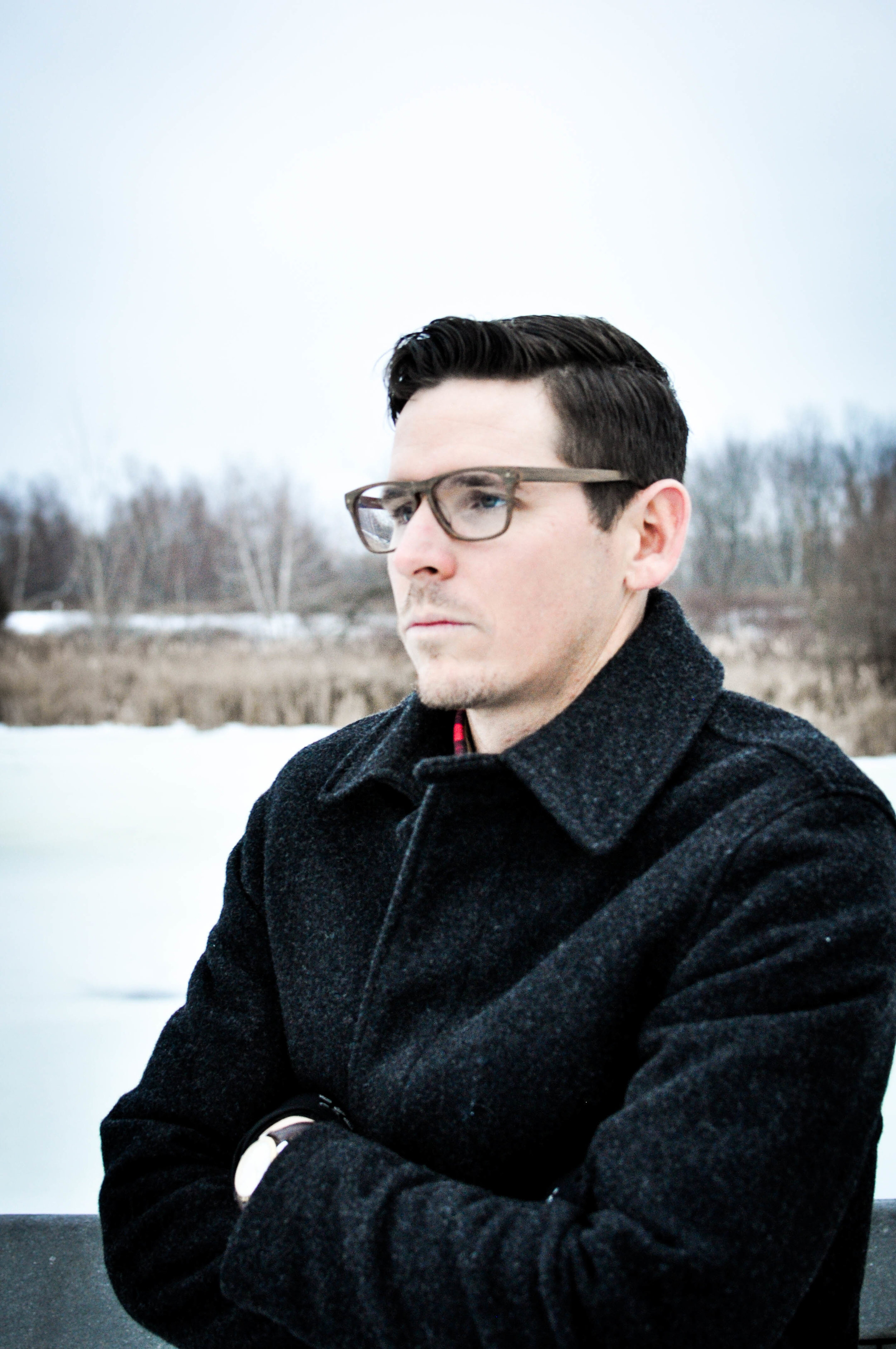 Man with glasses in snow