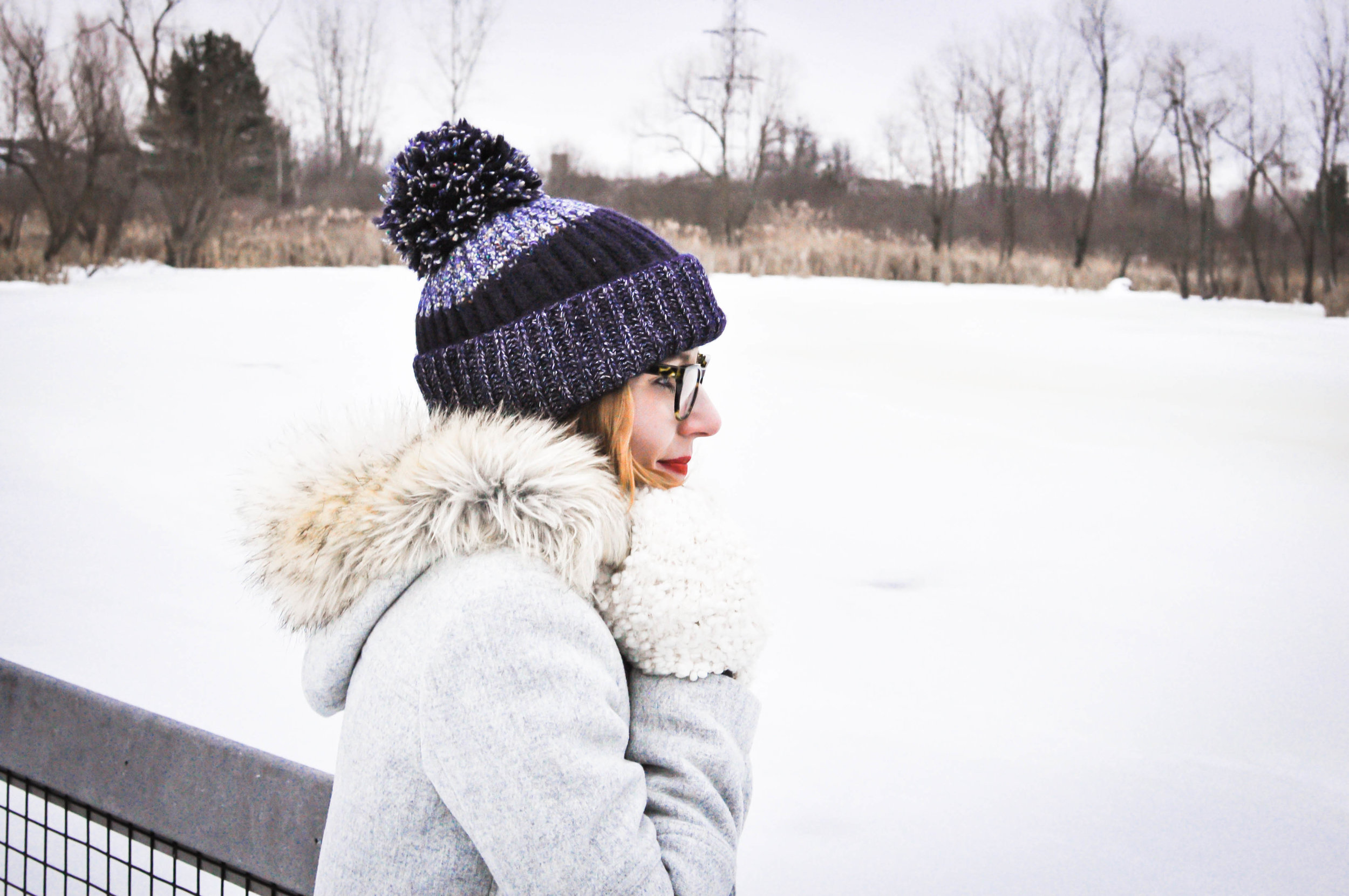 Woman in winter clothes in the snow