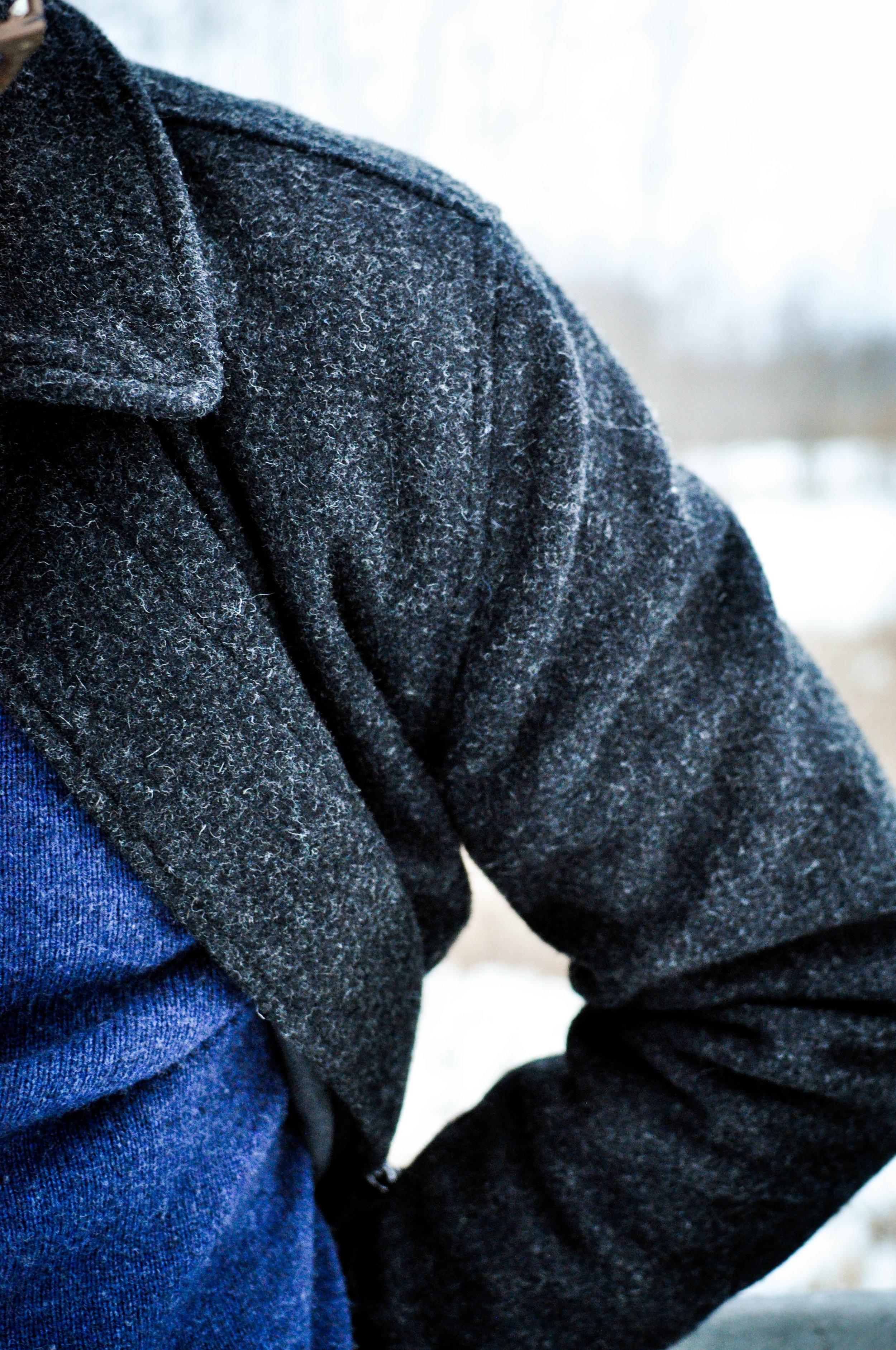 Up close shot of man's gray wool coat