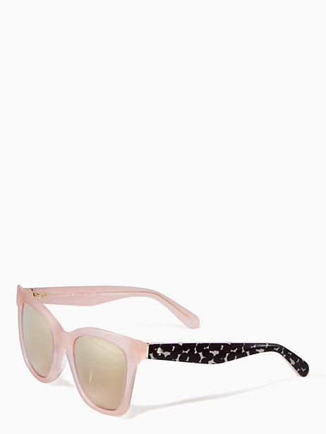 Pink-rimmed Kate Spade sunglasses with black side pieces