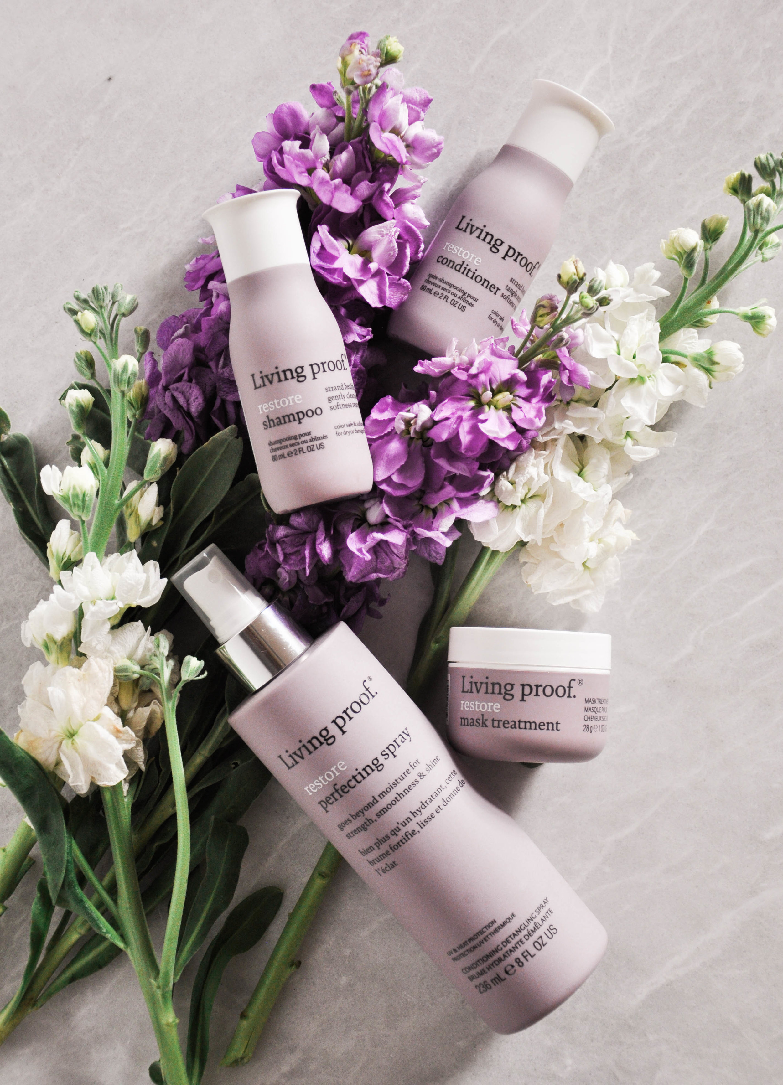 living proof restore hair products on flowers