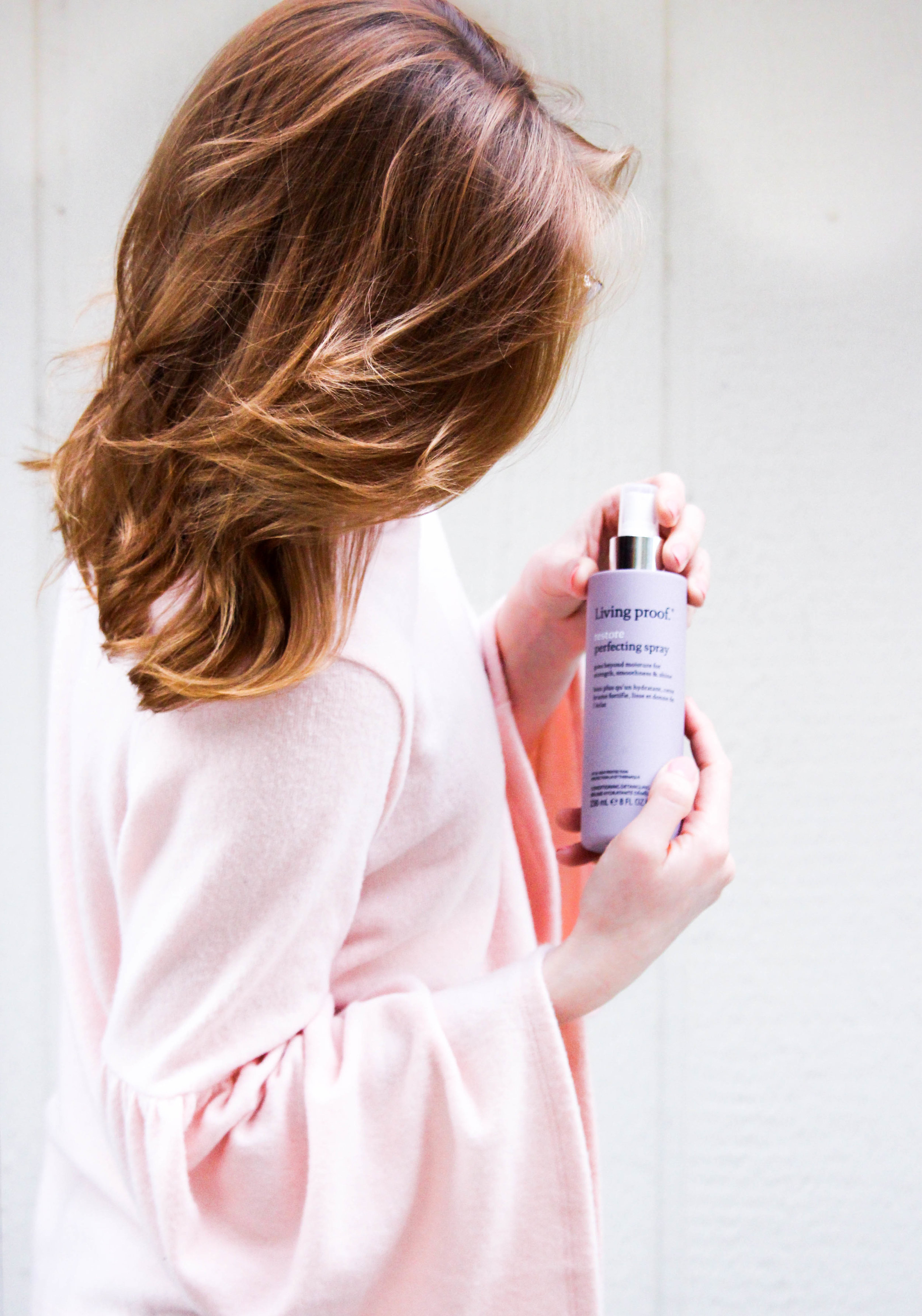 woman holding hair care product