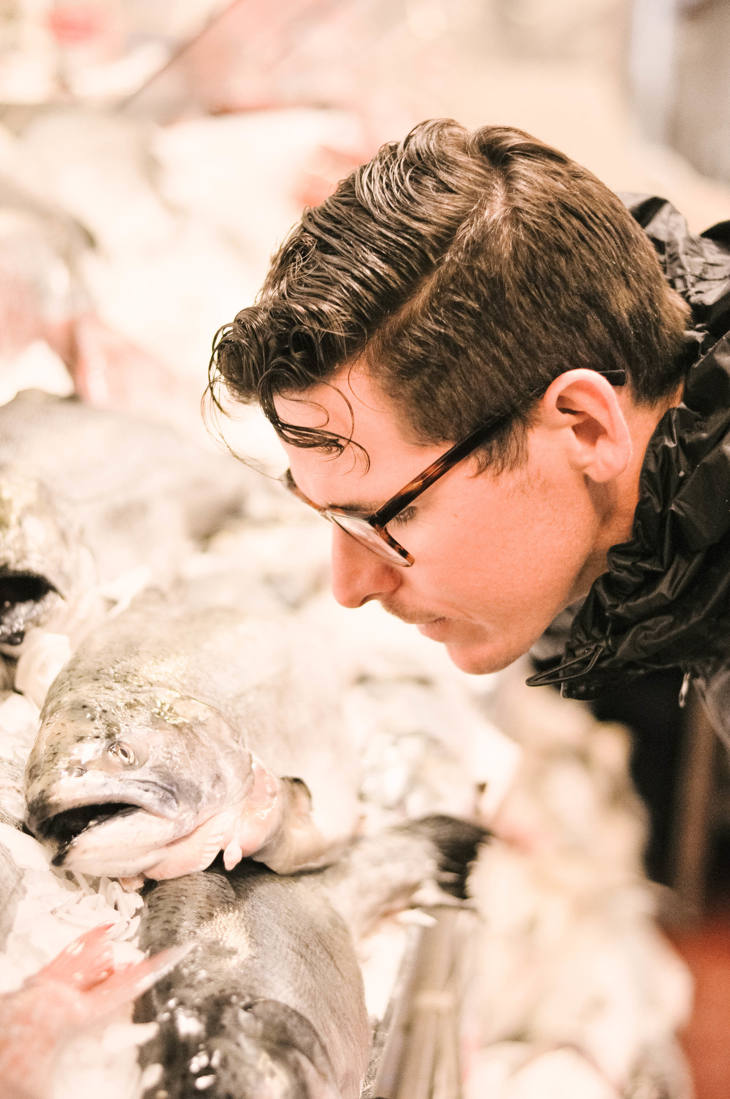 Man in glasses at Seattle fish market