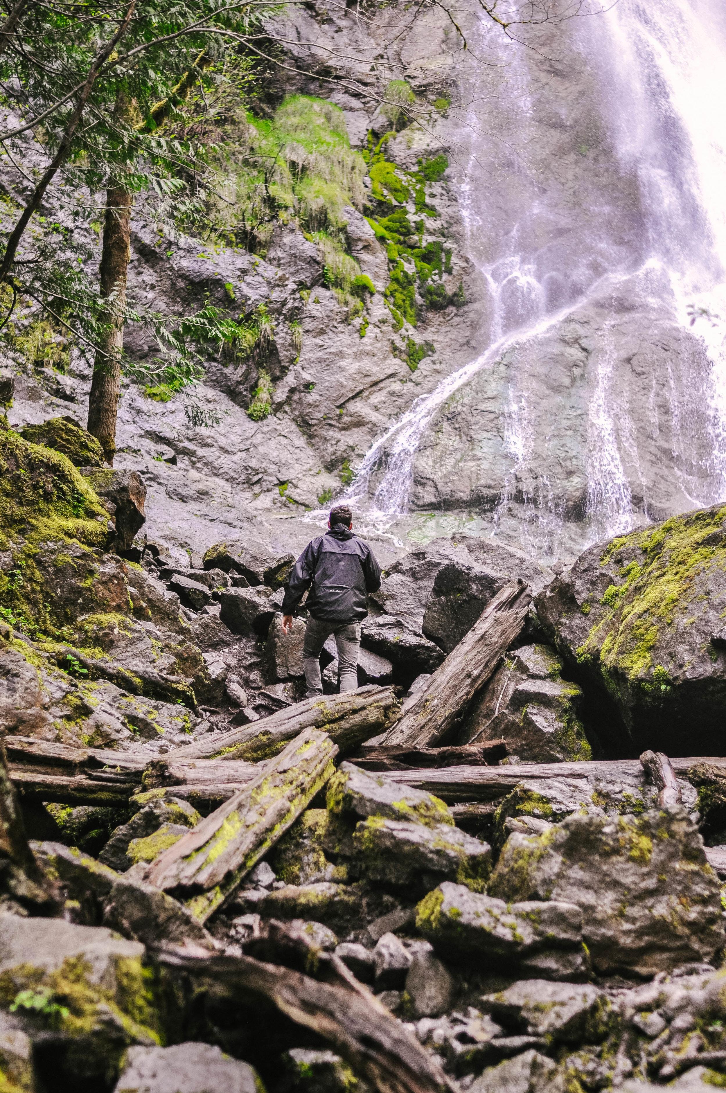 Man near Washington waterfall