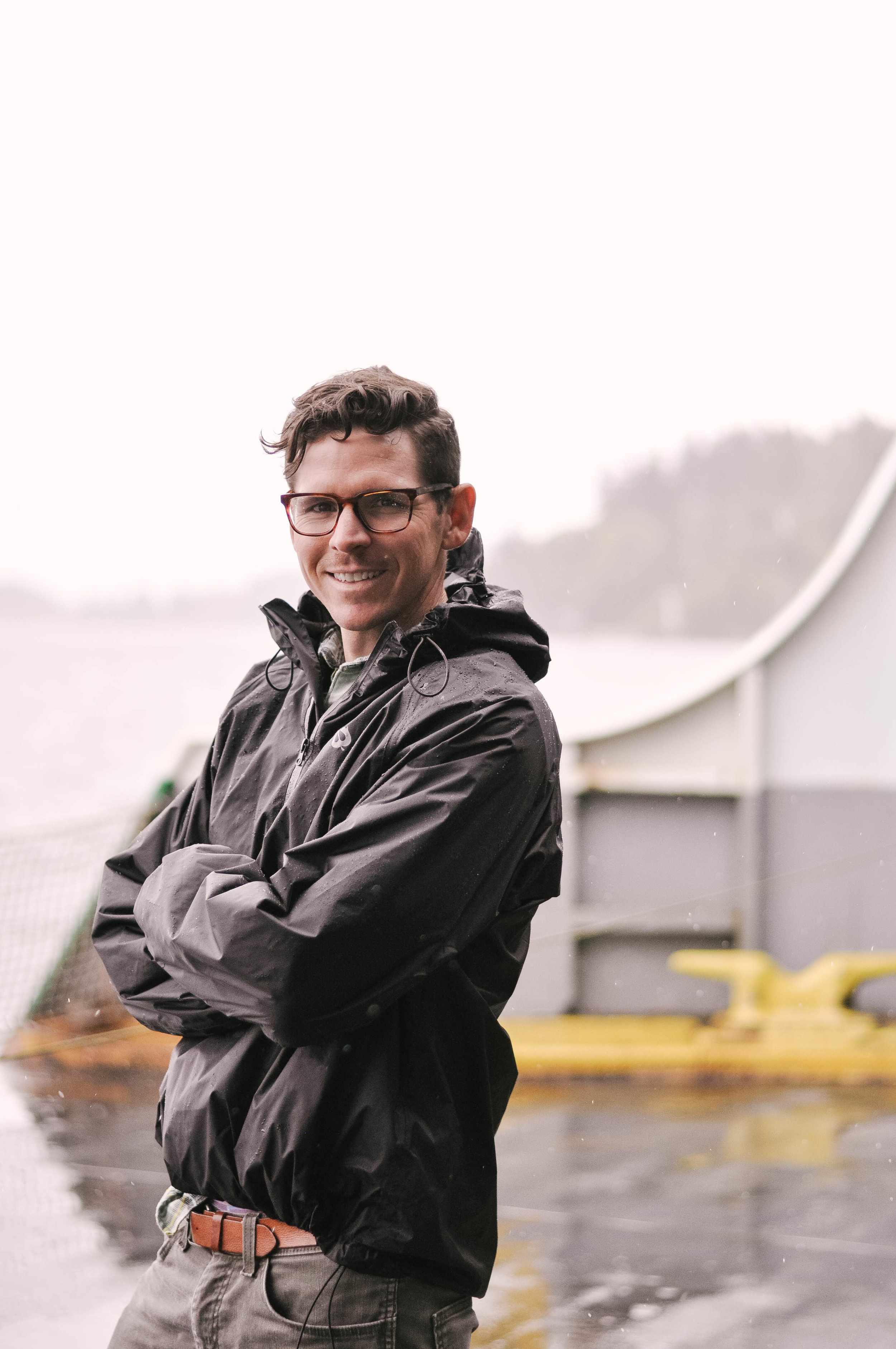 Man in raincoat on boat
