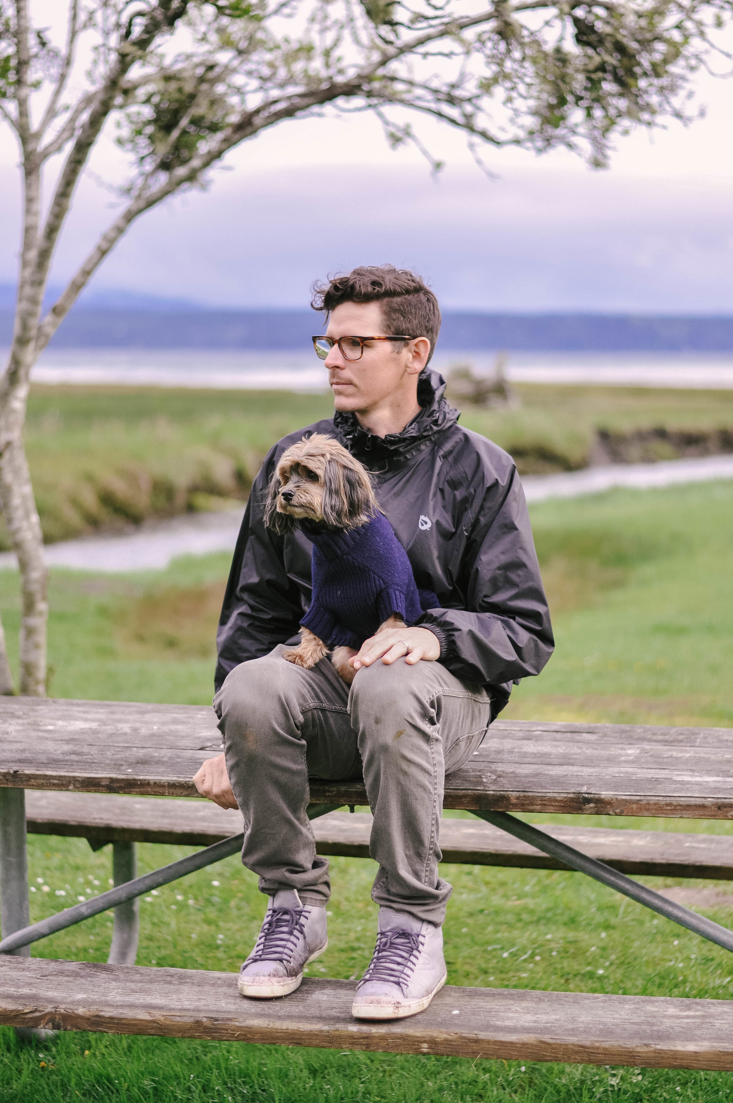 Man and his dog on wooden picnic table