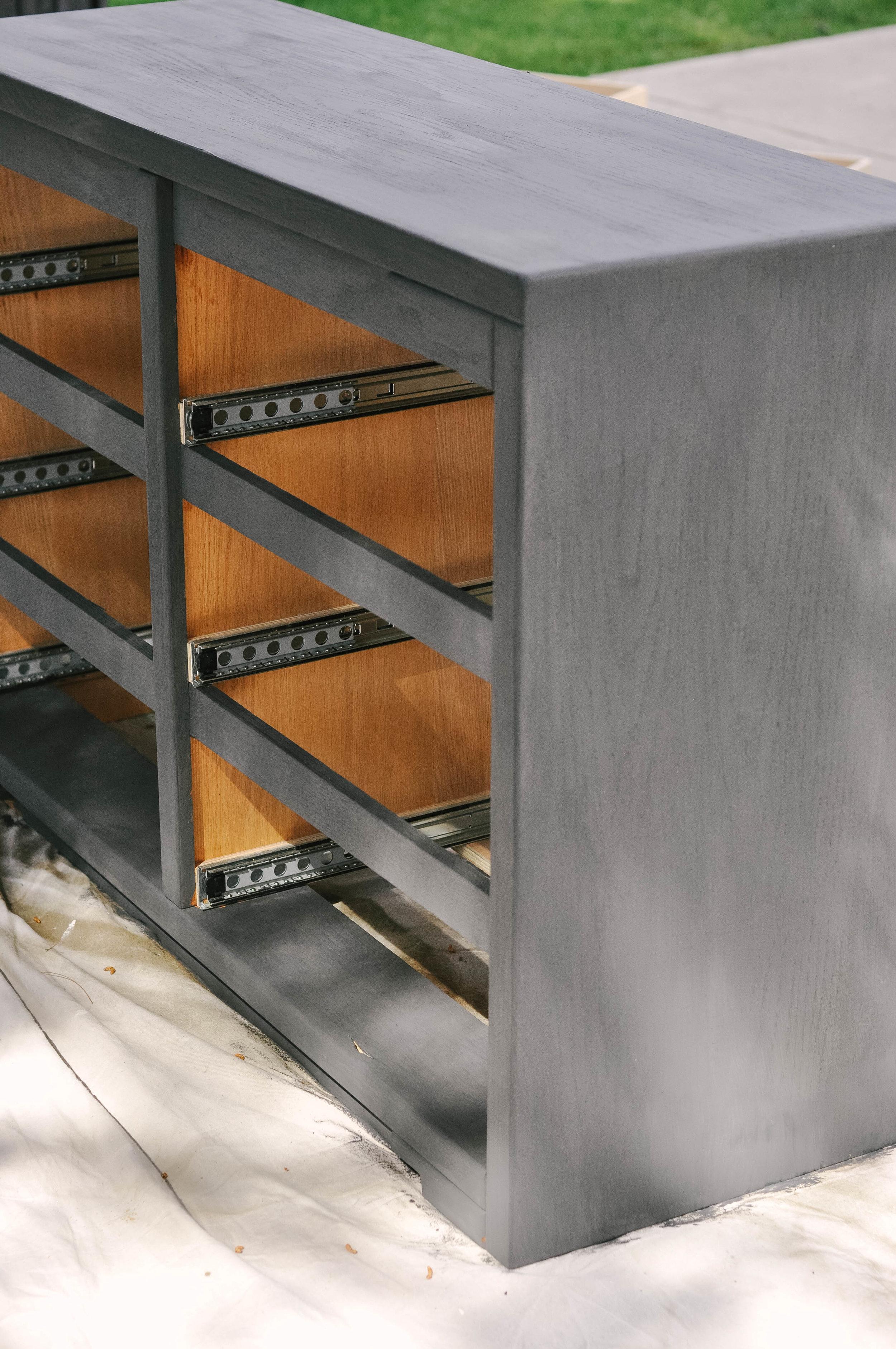 dark painted wood dresser open drawers