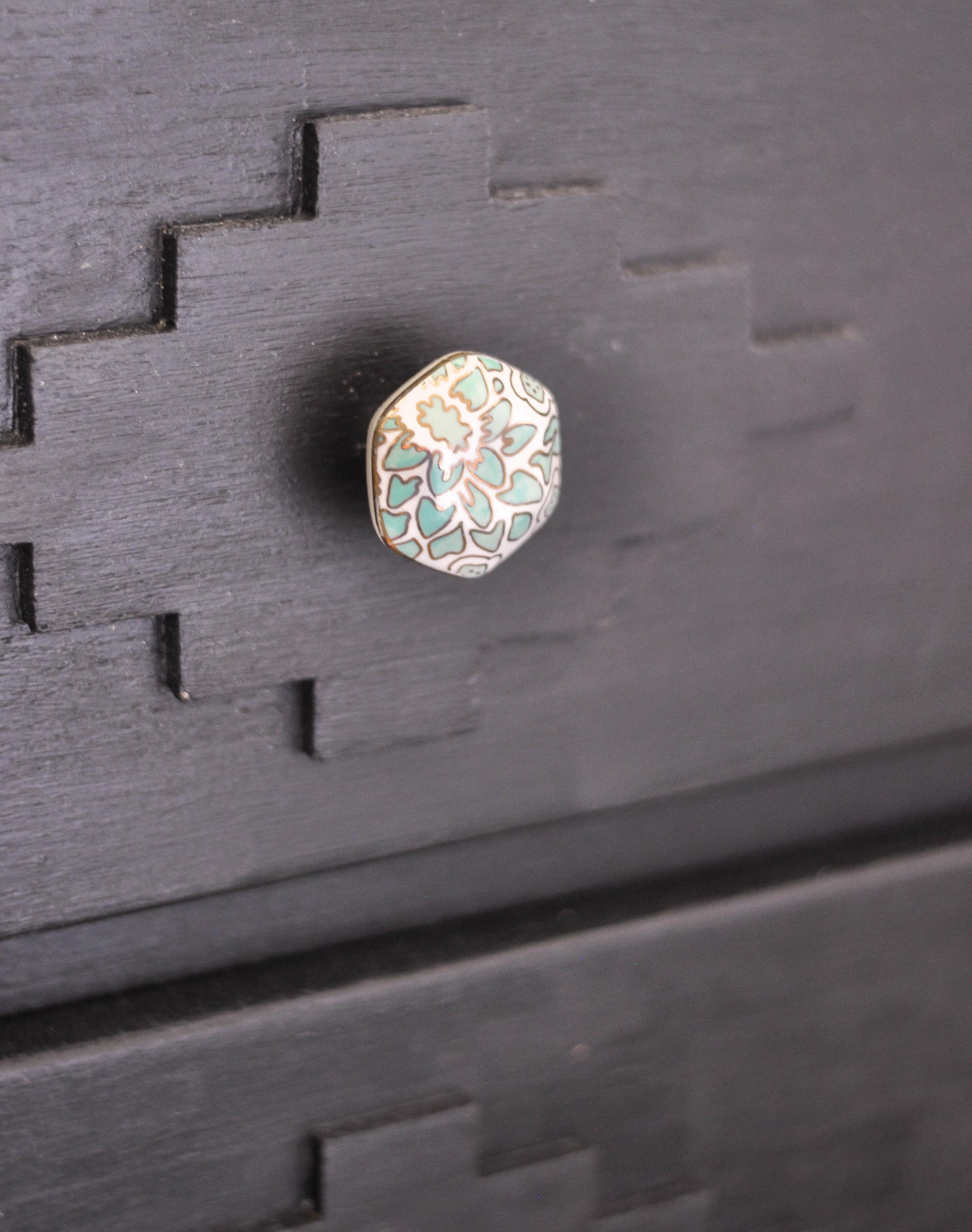 anthropologie decorative knob on black wooden dresser