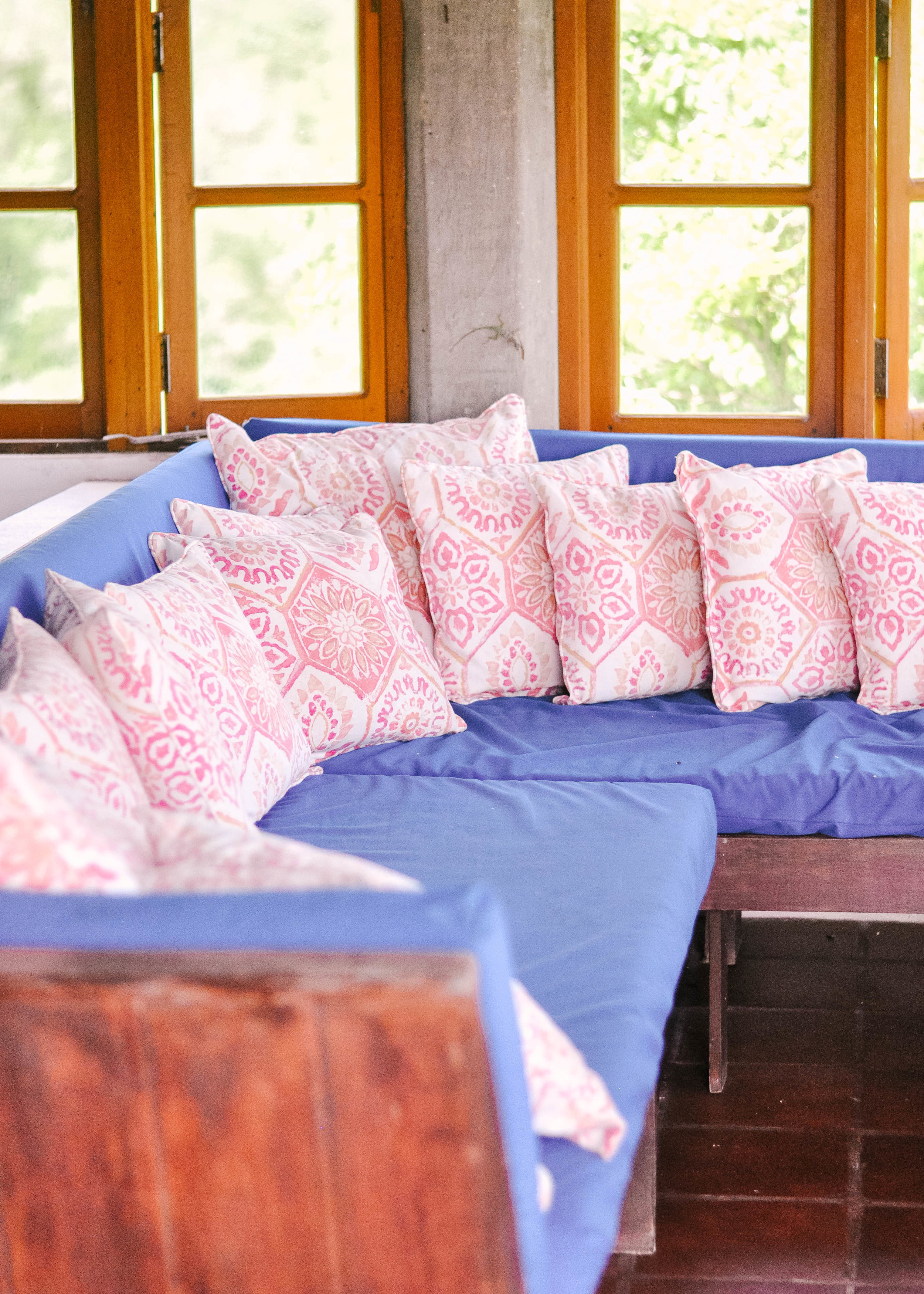 Pillows on blue cushion couch