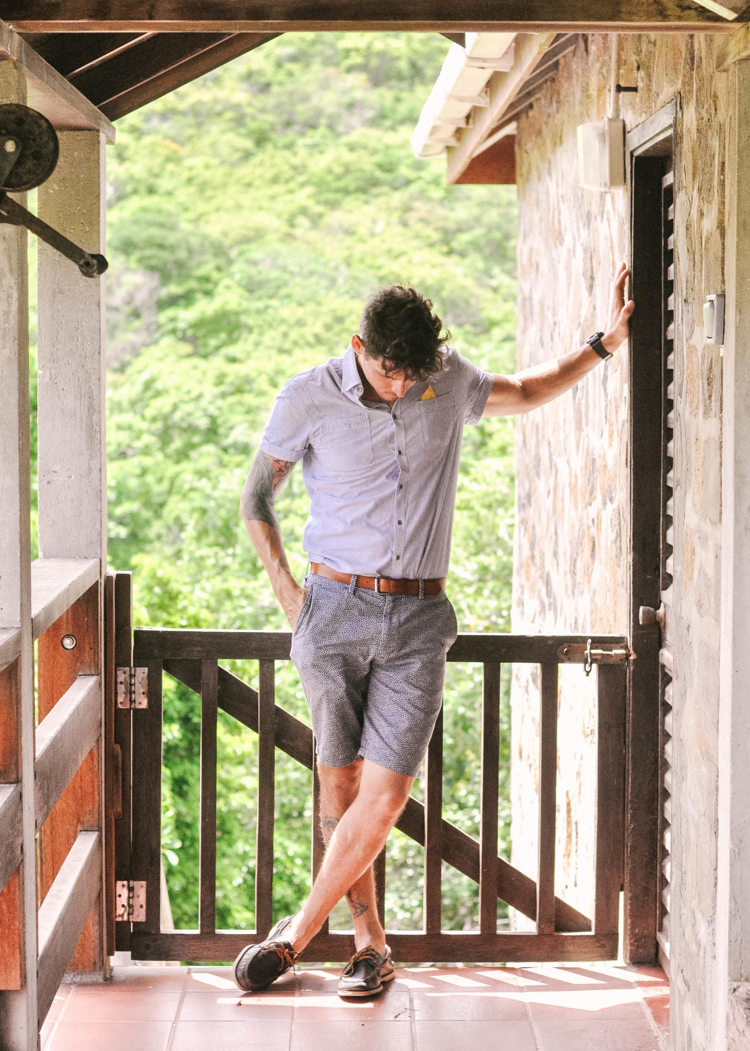 Man next to wooden railing