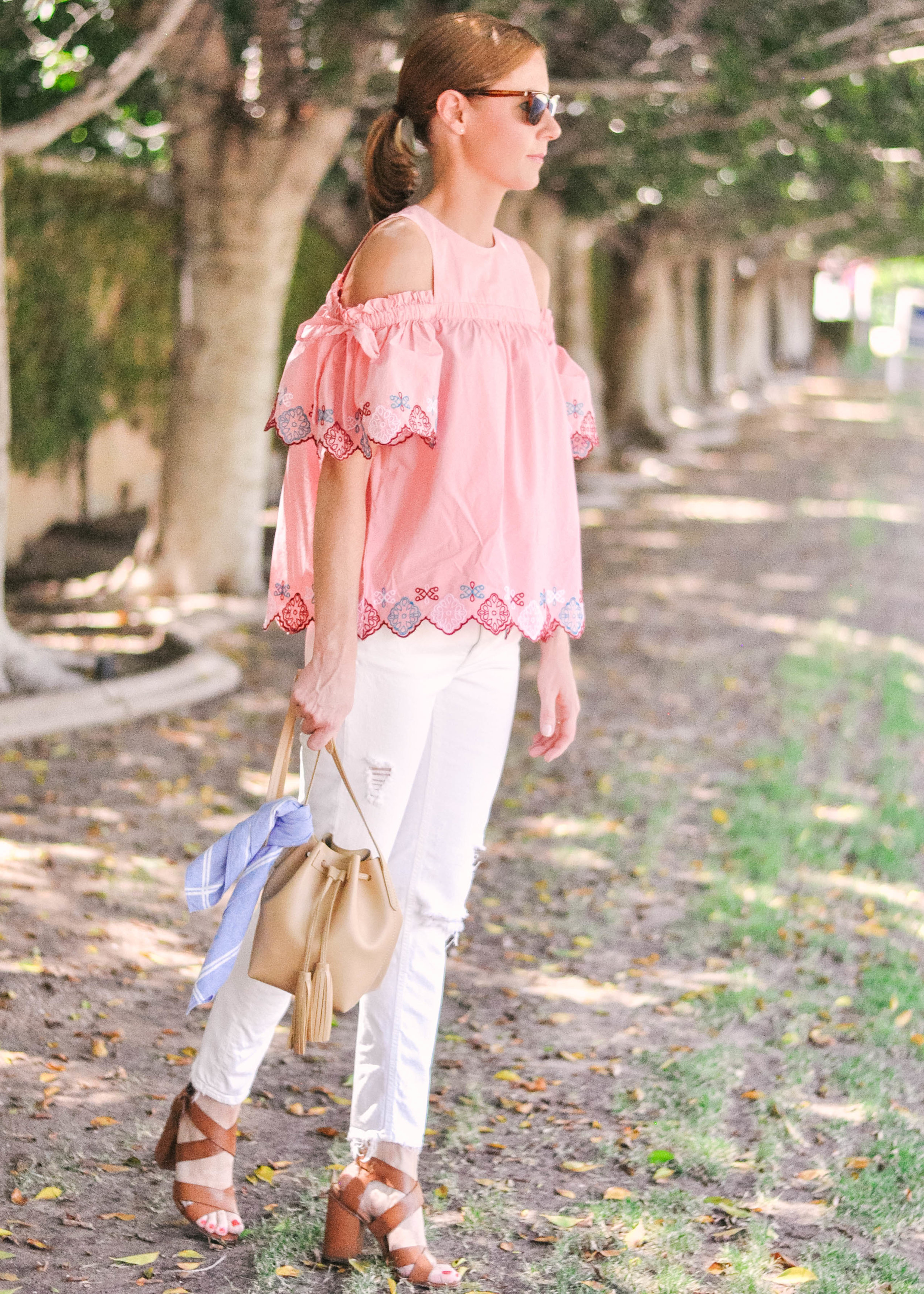 woman in pink Loft top and white jeasn from Zara