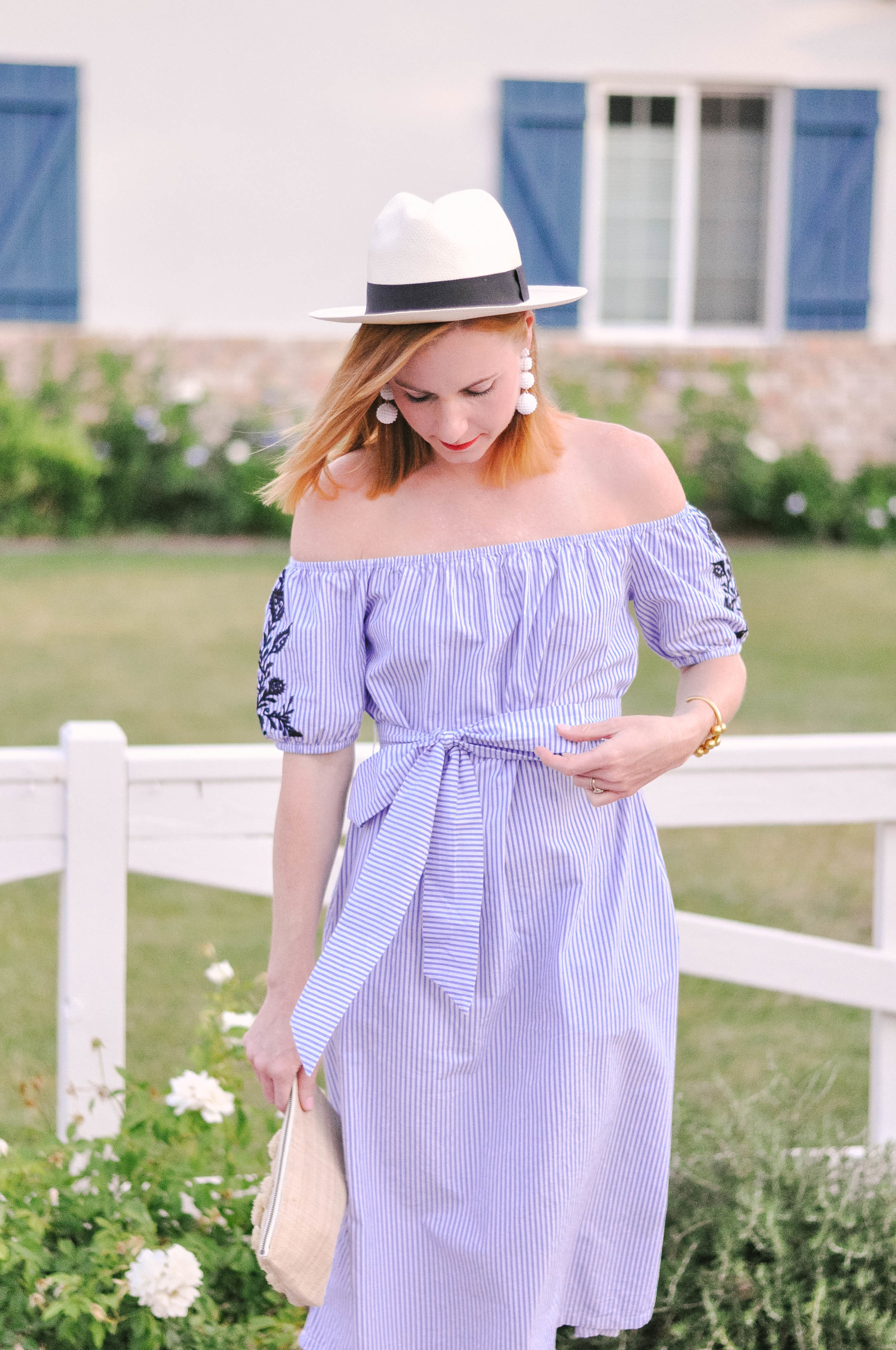 woman in summer dress and hat