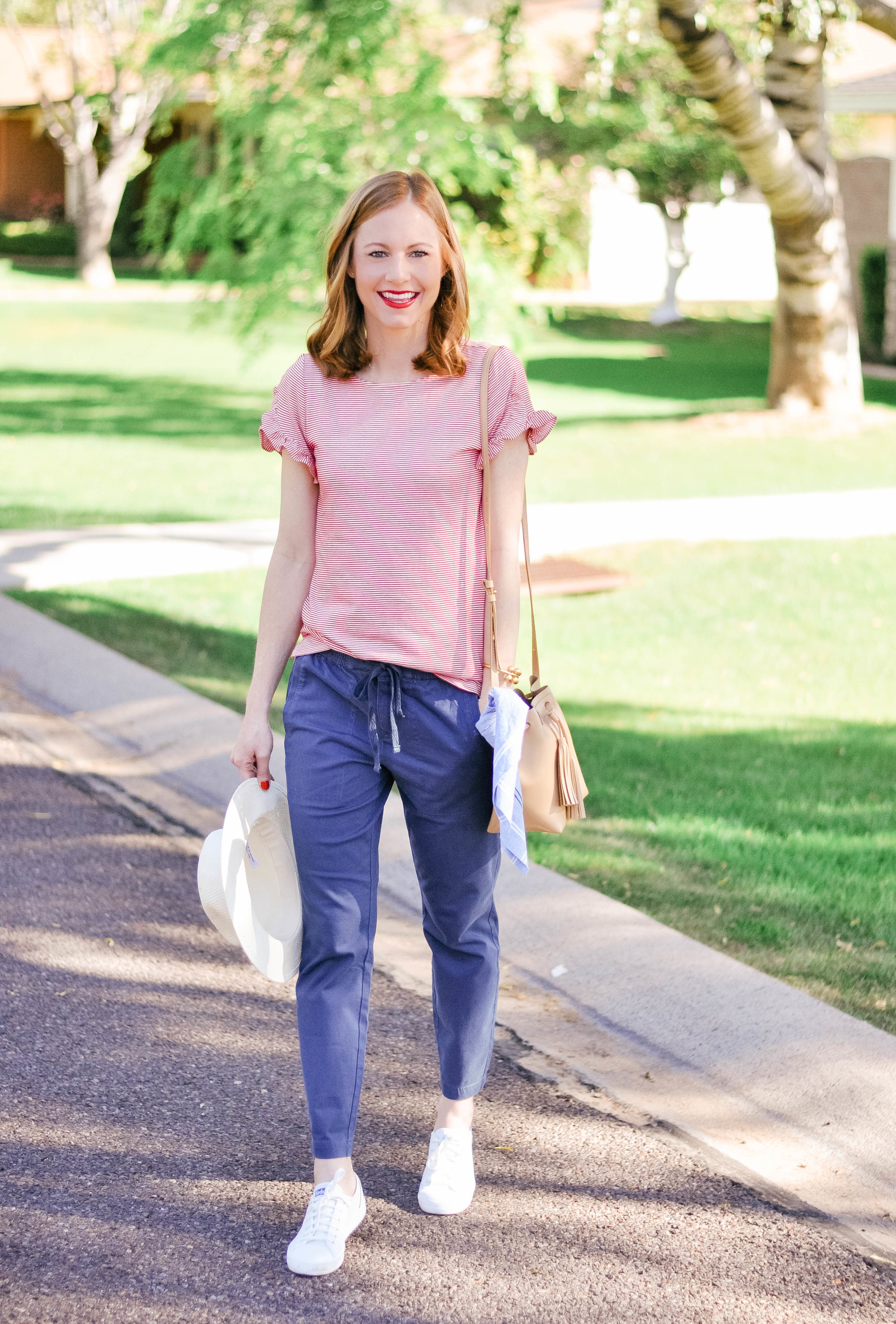 smiling woman in jeans and tee