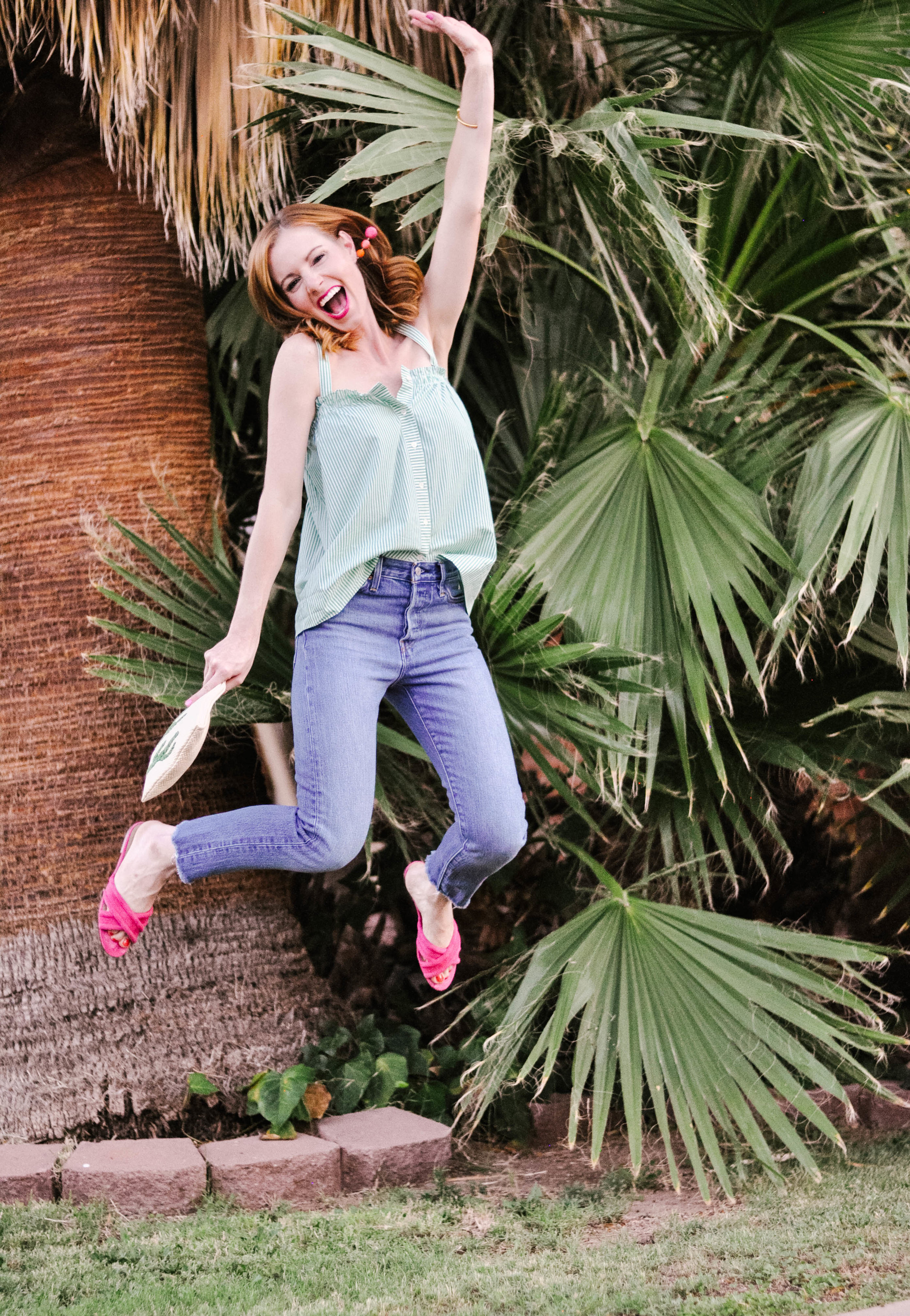 Woman Jumping in Casual Summer Outfit