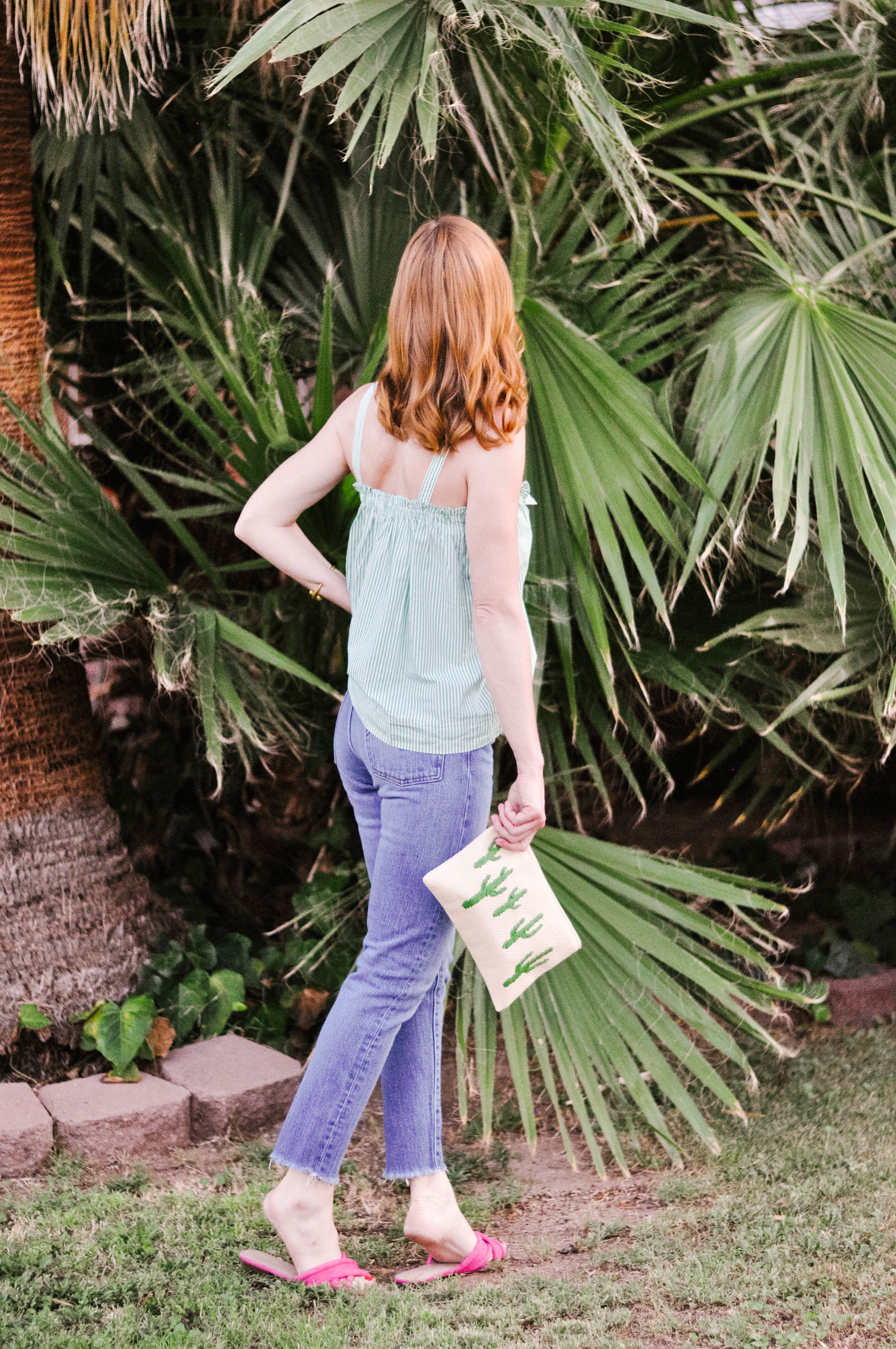 Girl Standing in Front of Palm Tree in Casual Summer Style